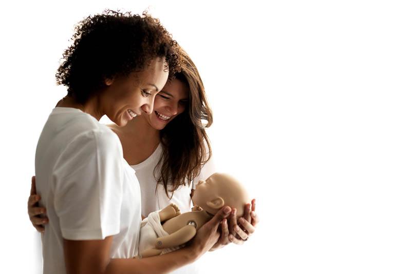 Infant training simulation doll