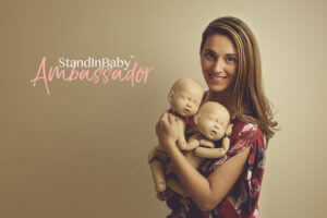 Amanda Angelo newborn photographer with posing doll standinbaby